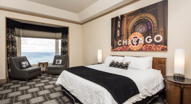 King bed with Chicago art behind and window with view to the side