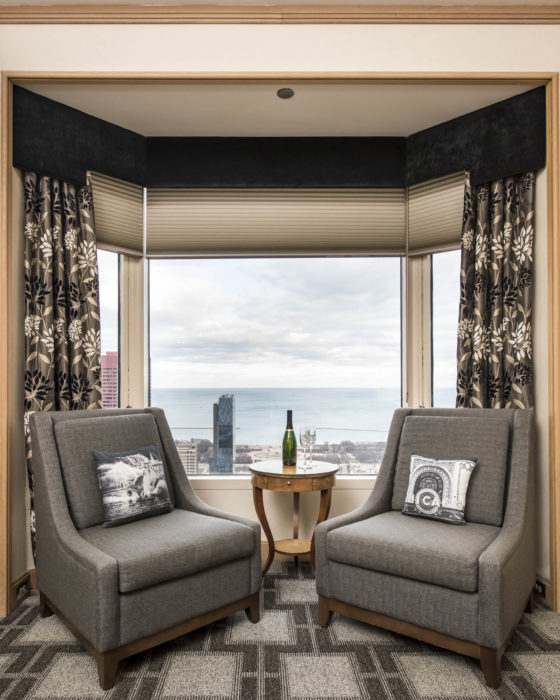 Hotel Guestroom Sitting Area with Two Chairs and View of Lake