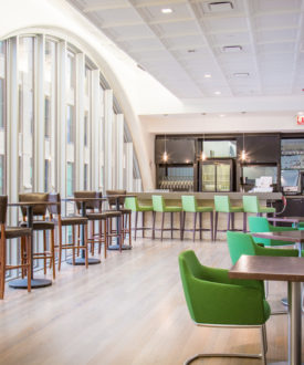 Bar with Tables and Green Chairs