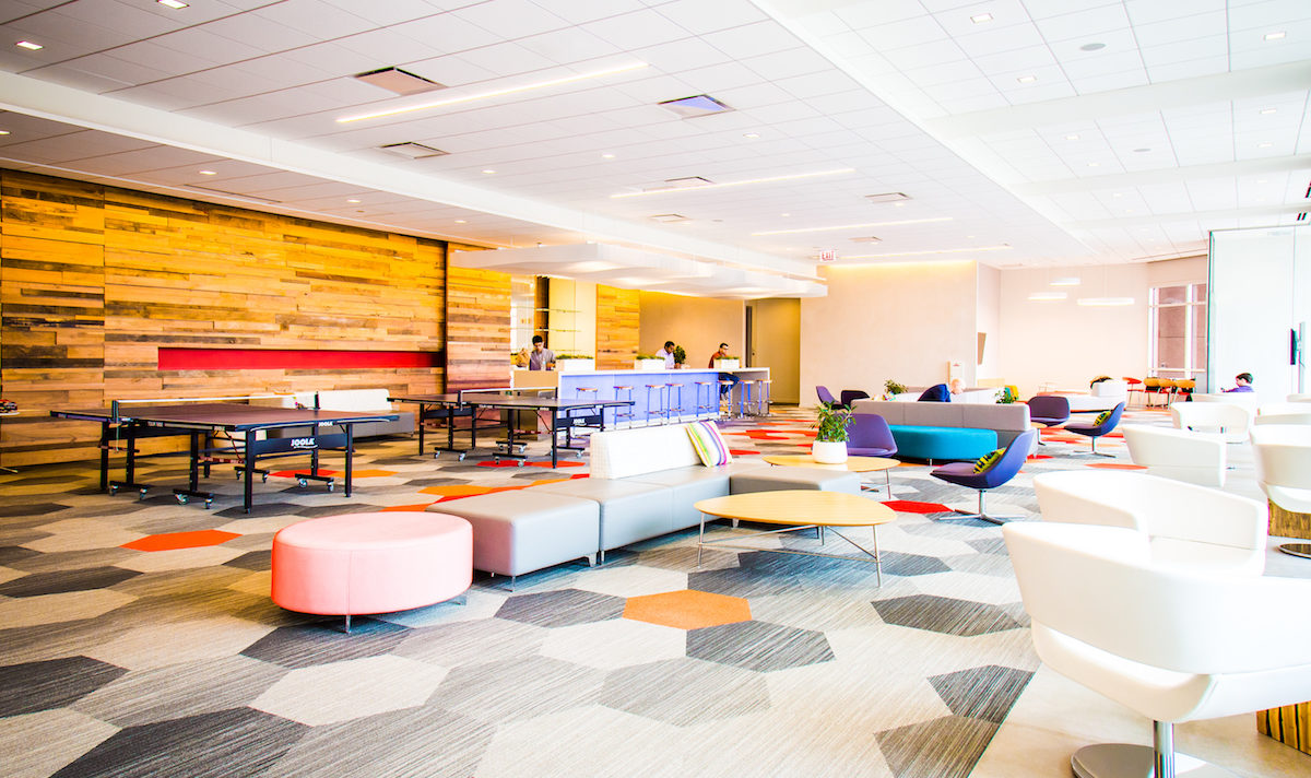 Lounge with colorful furniture and patterned floor